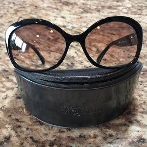 Alexander McQueen sunglasses.